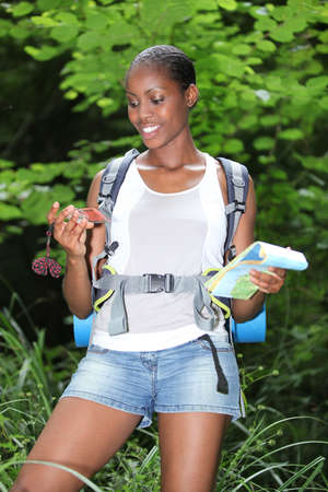 orienteering: Young woman with a map