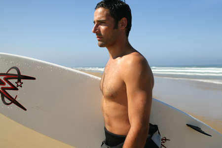 Man going surfing photo