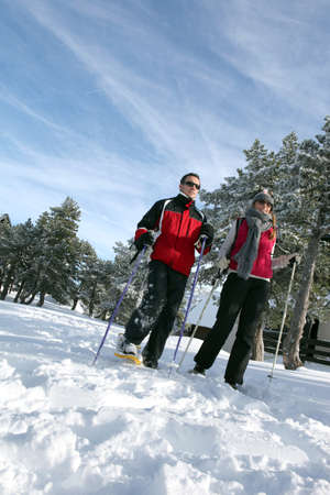 Couple going skiing photo