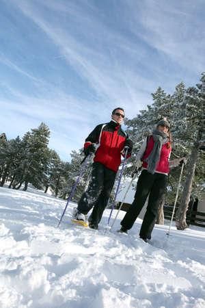Couple going skiing photo