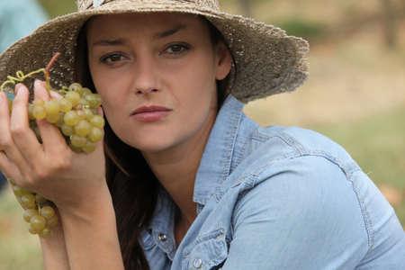 Woman holding grapes photo