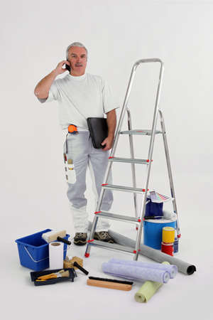 Experienced decorator on the phone to customer Stock Photo - 12218377