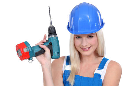 beautiful platinum blonde holding electric drill photo