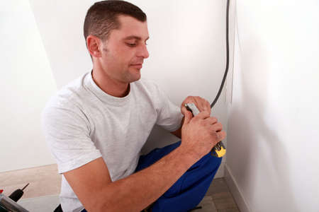 Electrician cutting a wire photo