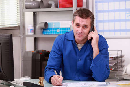 telephone salesman: Man on the phone in a plumber