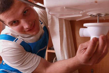 blockage: Plumber repairing sink