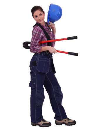 Female builder with bolt cutters photo