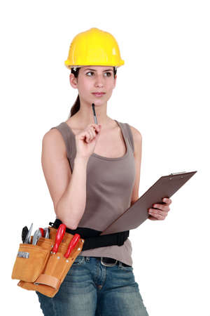 think safety: Tradeswoman completing an evaluation