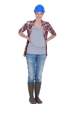Full-length portrait of a smiling tradeswoman Stock Photo - 12217875
