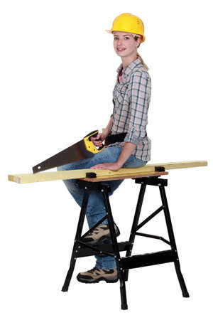Female carpenter with a saw photo