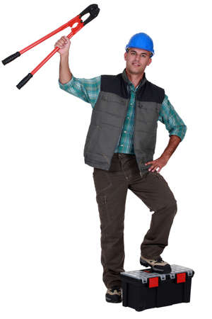clippers: Tradesman holding up a pair of large clippers Stock Photo