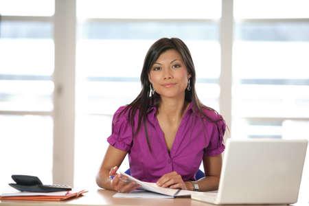 beautiful Asian businesswoman working photo
