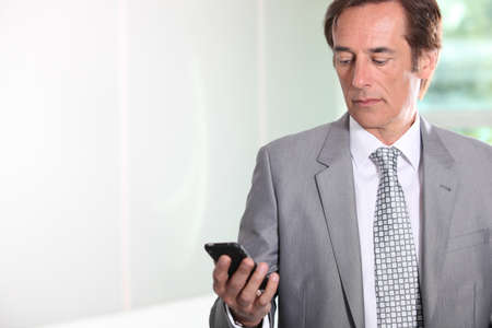 Businessman texting Stock Photo - 12218577