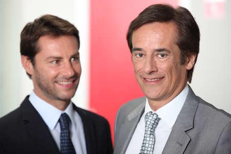 Two businessmen smiling Stock Photo - 12218410