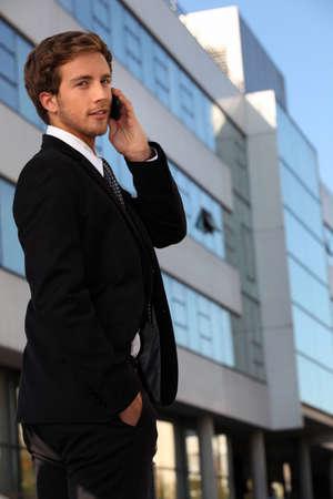 Young executive using a cellphone photo