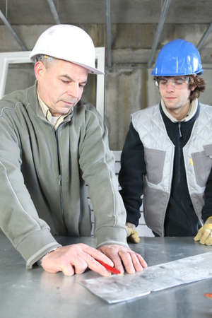 apprentice: Electrician with young apprentice