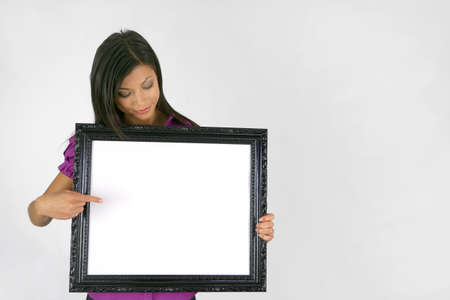 Woman pointing to empty picture frame Stock Photo - 12217868