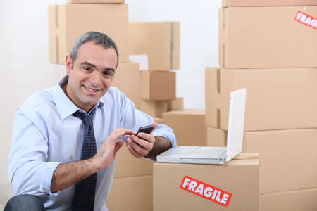 portrait of a man with cardboard boxes photo