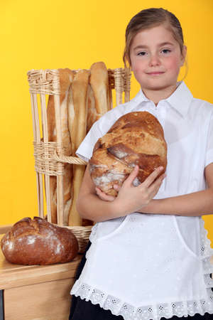 french bread: Young girl with fresh bread