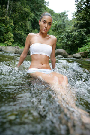 tube top: Attractive woman bathing in a river