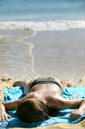 woman lying on the beach photo
