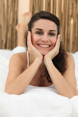 Smiling woman in bed Stock Photo - 12218553