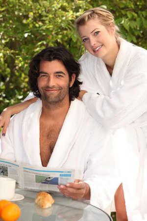 bath gown: Couple having breakfast outside