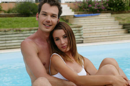 couple embracing by the pool photo
