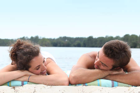 Couple relaxing on the beach photo