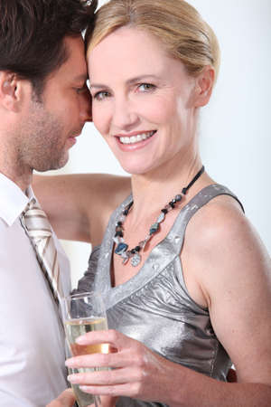 clinch: Man and woman in a clinch, dancing and drinking champagne