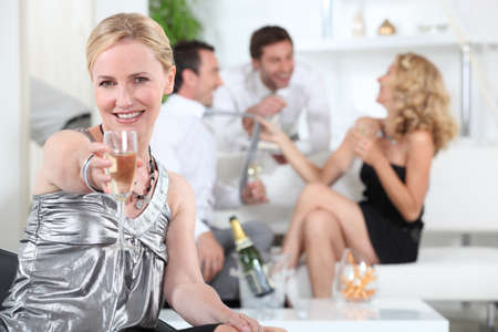 high spirited: Woman with glass of champagne Stock Photo