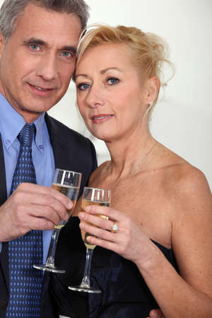 Mature couple toasting with champagne. photo