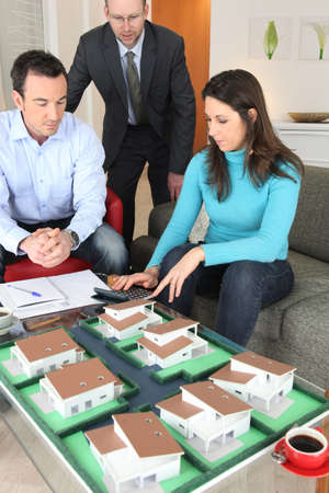 architecture model: Couple calculating the cost of their new home