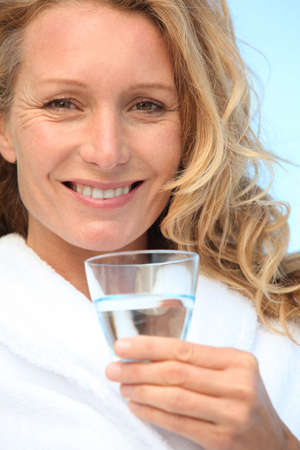 grown ups: Woman with a glass of water Stock Photo