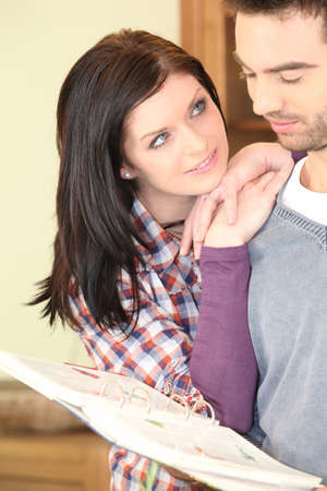 tenderly: Young woman looking at her boyfriend tenderly Stock Photo