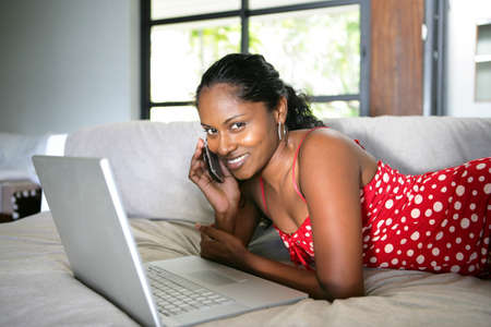 Afro-American woman relaxing on the couch photo