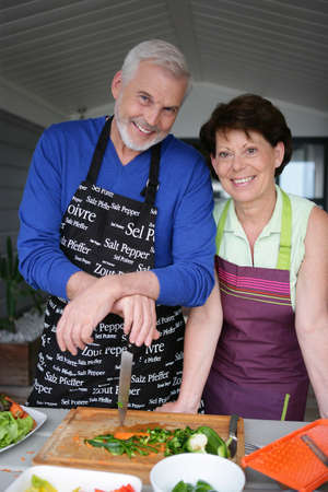 sixty: Older couple preparing an outdoor lunch Stock Photo