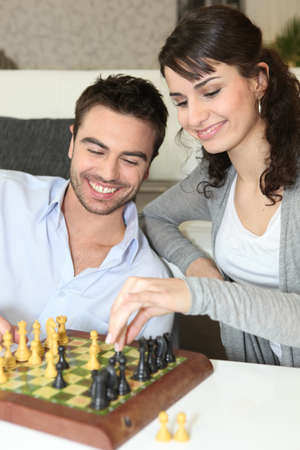 pawn adult: Couple playing chess
