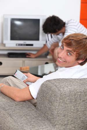Turning on the TV. photo