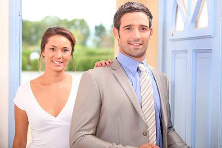 arriving: Couple arriving home Stock Photo