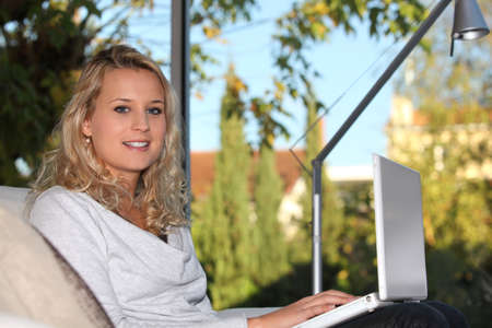 Teenage girl using a laptop computer photo