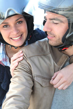 Smiling couple  having a bike ride photo