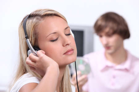 enraptured: Young woman completely enthralled by a song