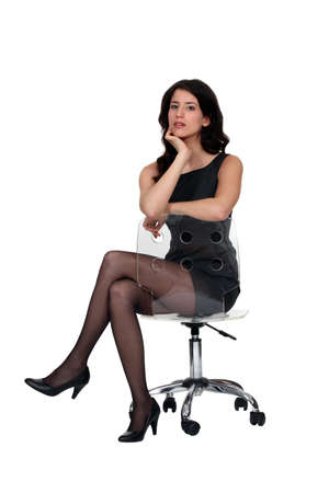 choleric: Woman sat on office chair Stock Photo