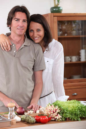 Couple preparing dinner in the kitchen Stock Photo - 12218684