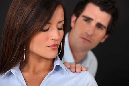 Concerned man touching his wife