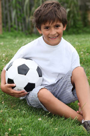 child ball: Little boy with football Stock Photo