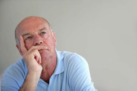 retirees: A thoughtful elderly man
