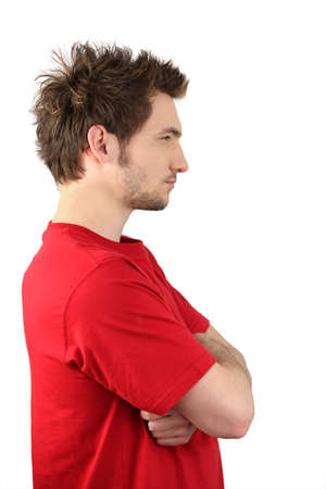side profile: Profile view of man stood with arms crossed