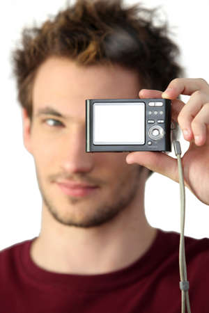 compact: young man holding digital camera